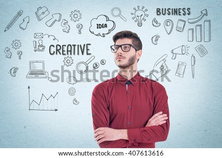 Young business man looking up and planning. Graphic sketch style thoughts overhead - stock photo