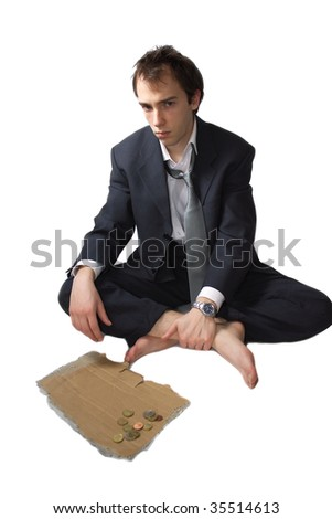 Young business man made redundant begs, and got some change - stock photo
