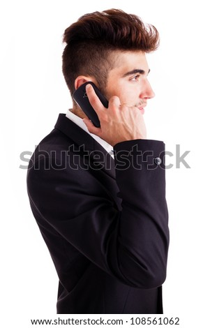 Young business man on the phone, isolated on white - stock photo