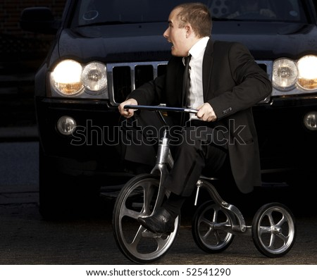 Young business man on tribike - stock photo