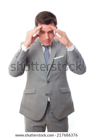 Young business man over white background. Showing headache