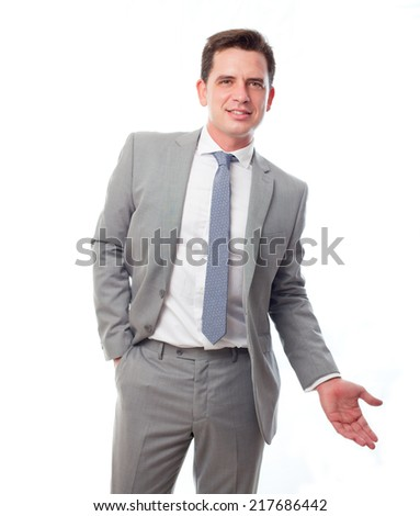 Young business man over white background. Showing his hand - stock photo
