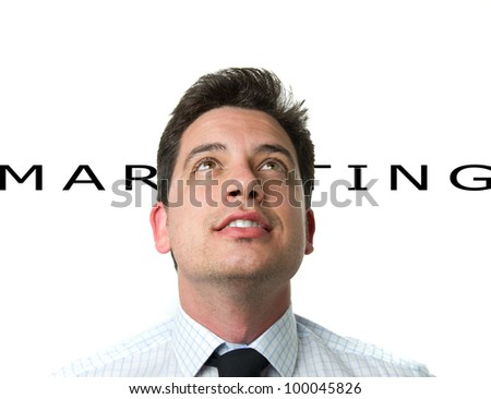 Young business man over white monochrome background and the word marketing - stock photo