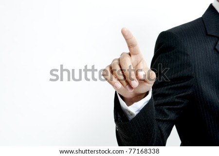 Young business man pointing to you - stock photo