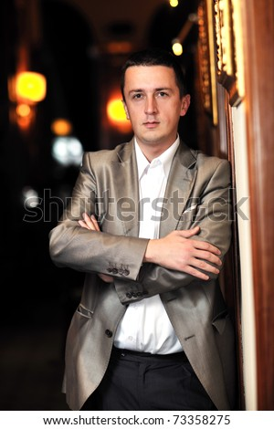 young business man portrait at night bar restaurant at conference seminar meeting