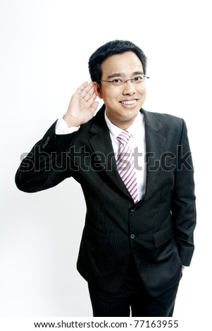 young business man portrait in white background (keep listening) - stock photo