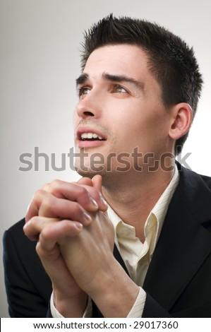 Young business man praying close up shoot - stock photo