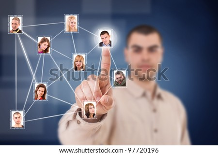 Young business man pressing Social network structure - stock photo