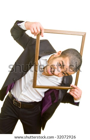 Young business man putting his head through an empty frame - stock photo