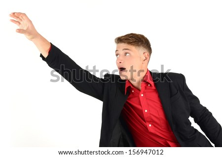 Young business man reaching up in desperation. Isolated on white background. - stock photo