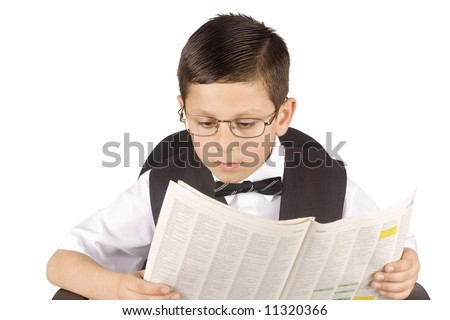 Young business man reading the newspaper - stock photo