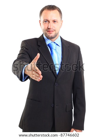 Young business man ready to set a deal over white background - stock photo