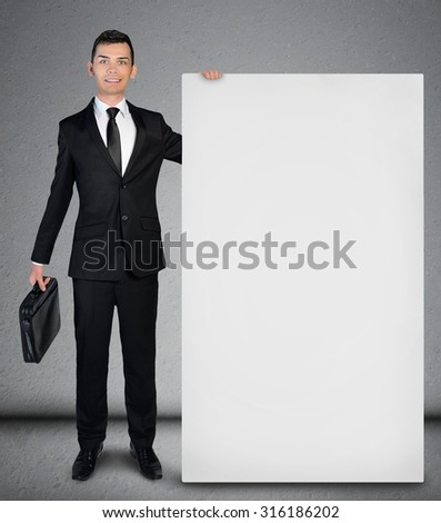 Young business man showing empty board - stock photo