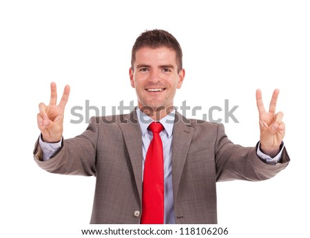 young business man showing victory gesture with both hands isolated on white background - stock photo