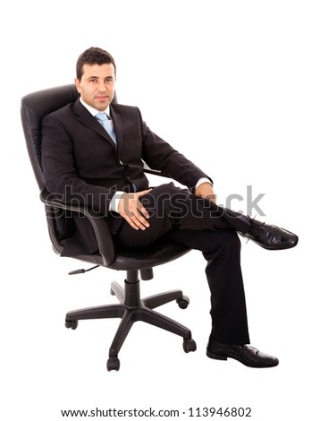 Young business man sitting in a chair and relaxing, isolated on white