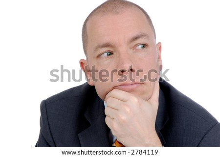 Young business man sitting in a office. Studio picture - stock photo