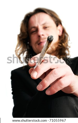 Young business man smoking weed after work - stock photo