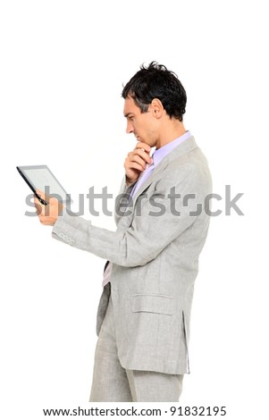 young business man standing reading a tablet isolated on white background