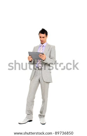 young business man standing using a tablet  isolated on white background - stock photo