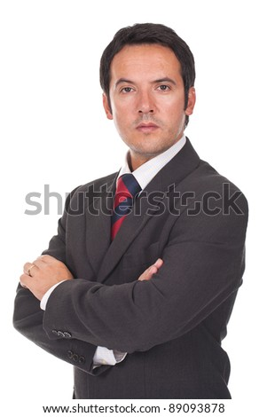young business man standing with arms crossed - stock photo