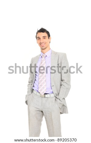 young business man standing with hands in pocket  isolated on white background
