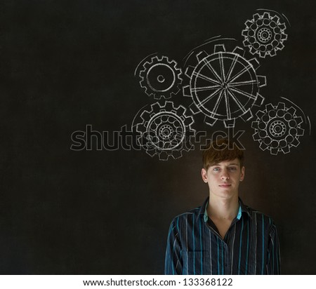 Young business man, student or teacher thinking with turning gear cogs or gears - stock photo