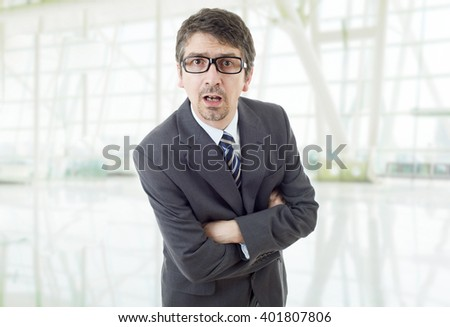young business man surprised at the office - stock photo