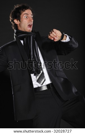 Young Business Man Surprised by Time - stock photo
