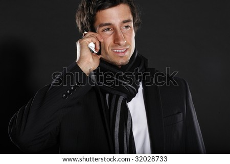 Young Business Man Talking on Cellular Phone - stock photo