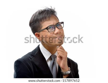 Young business man thinking - stock photo
