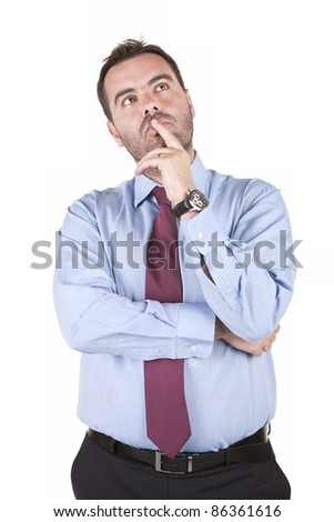 young business man thinking and looking up isolated over white background - stock photo