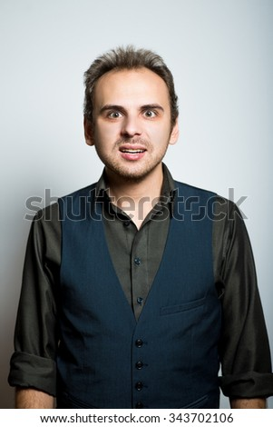 young business man upset manager office concept, shot isolated on gray background - stock photo