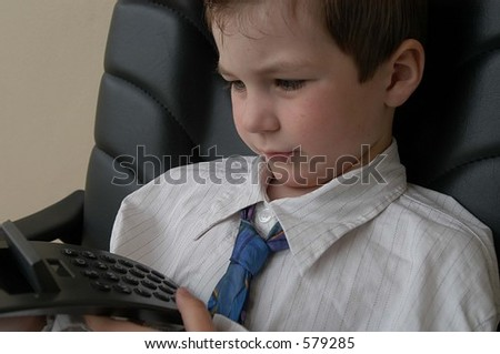 young business man using calculator