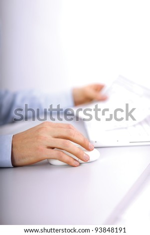 young business man using laptop and smiling