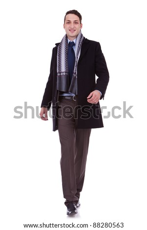young business man walking forward over white background - stock photo