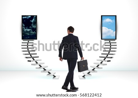 young business man walking near two  ladder, looking to make a decision