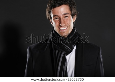 Young Business Man Wearing Scarf Smiling - stock photo