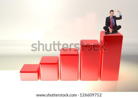young business man winning , sitting on a big graph bar - stock photo
