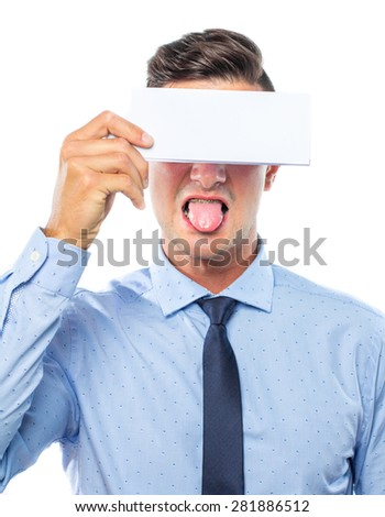 Young business man with a blank card on his eyes