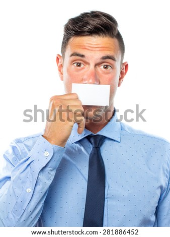 Young business man with a blank card on his mouth