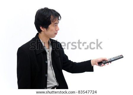 Young Business man with a remote control on white isolated background