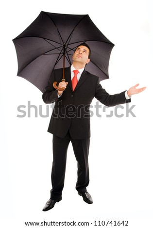 Young business man with an umbrella checking the rain on white background - stock photo