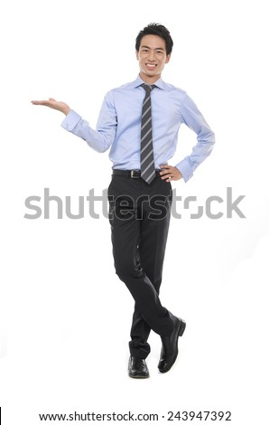 Young business man with arm out in a welcoming gesture  - stock photo