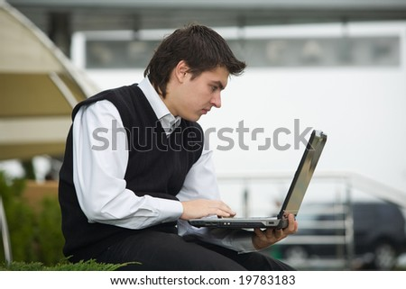 young business man with computer on background business centre