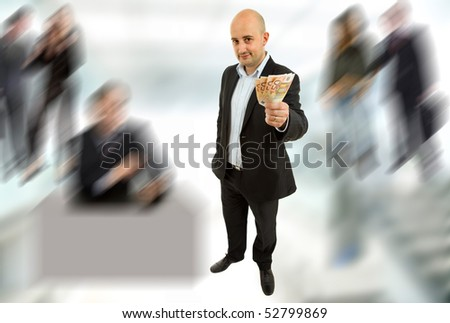 young business man with money, full length picture - stock photo