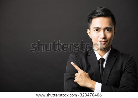 young  business man with pointing gesture - stock photo