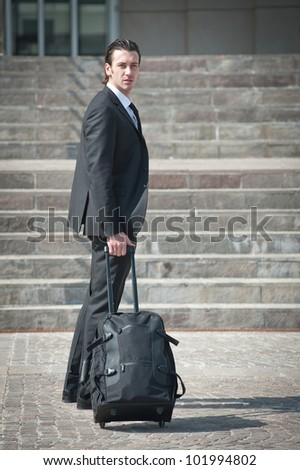 Young business man with suitcase. - stock photo