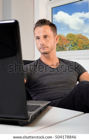 young business man working at a laptop