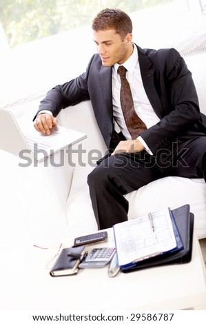 Young business man working in the office - stock photo