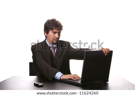 young business man working on laptop isolated on white background